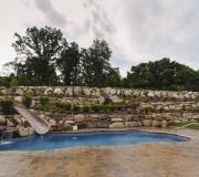 waterfall-slide-landscaping-pool-fox-hollow-waterslide-rock-wall-backyard