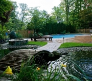 bridge-pool-fountain-landscaping-backyard-fox-hollow-fence-luxury-calm