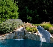 slide-pool-water-flowers-landscaping-fox-hollow-backyard-design