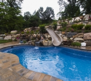 waterfall-slide-landscaping-pool-fox-hollow-backyard-rocks