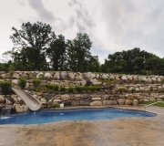 waterfall-slide-landscaping-pool-fox-hollow-waterslide-rock-wall-backyard