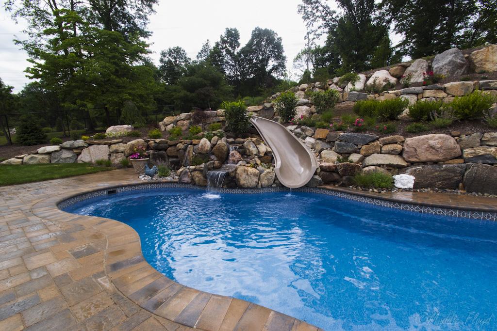waterfall-slide-landscaping-pool-fox-hollow-backyard-rocks